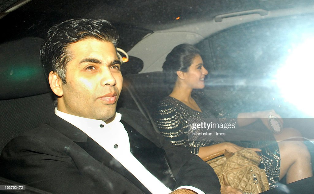 Indian Bollywood director and producer Karan Johar with actor Kajol Devgn arriving for the Steven Spielberg's party which is organised by Anil Ambani.