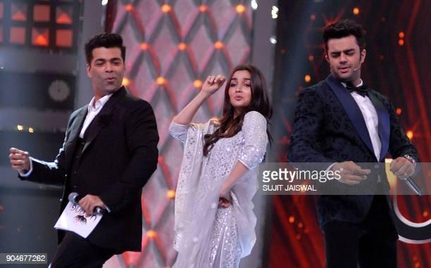 Indian Bollywood director Karan Johar and actors Alia Bhatt and Manish Paul take part in the'Umang Mumbai Police Show 2018' in Mumbai on late January...