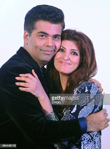 Indian Bollywood director Karan Johar and actress columnist and interior designer Twinkle Khanna pose for a photograph during the launch of Khanna's...