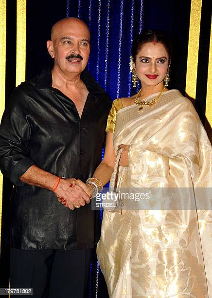 Indian Bollywood director Rakesh Roshan poses with actress Rekha during his 64th birthday celebration in Mumbai on September 6 2013 AFP PHOTO/STR