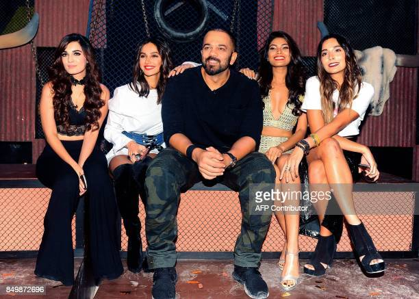 Indian Bollywood director Rohit Shetty and contestants pose for a photograph during a promotional event for the 'Khatron Ke Khiladi' reality show...