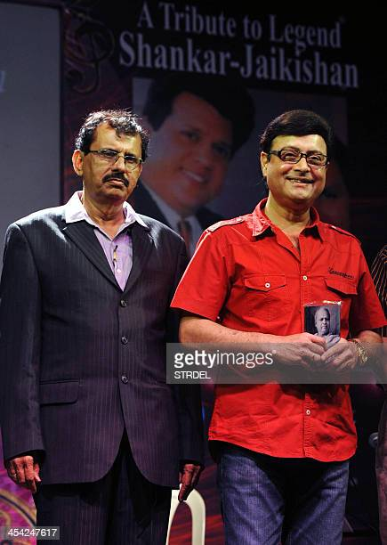 Indian Bollywood director Sachin Pilgaonkar and organiser Krishna kumar Gavand attend an event paying homage to late industry personalities Jaikishan...
