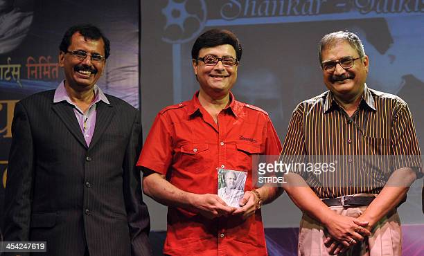 Indian Bollywood director Sachin Pilgaonkar flanked by organiser Krishna kumar Gavand and Chandrashekhar Pusalkar grandson of Dada Saheb Phalke...