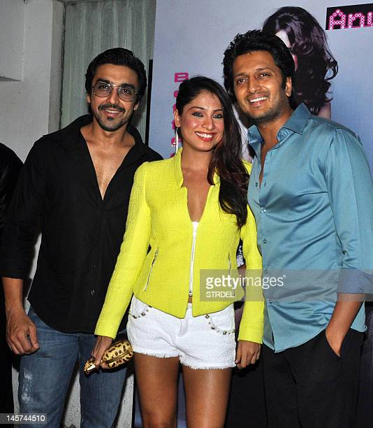 Indian Bollywood film actor Aashish Chaudhary his with wife Shamita and Ritesh Deshmukh pose during the release of Bollywood film actress video...