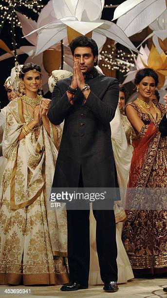 Indian Bollywood film actor Abhishek Bachchan attends the grand finale as models showcase creations by designer Rohit Bal at the 'Aamby Valley India...