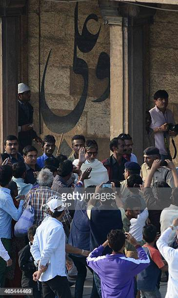 Indian Bollywood film actor Amitabh Bachchan waves to fans as he leaves the ancient Jama Masjid in Ahmedabad on Janaury 27 2014 Bachchan came to...