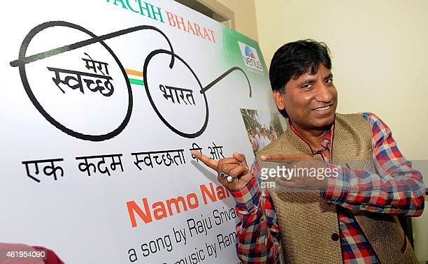 Indian Bollywood film actor and comedian Raju Srivastav poses at VENUS Worldwide Entertainment launch of Indias first song on 'Swach Bharat Abhiyaan'...