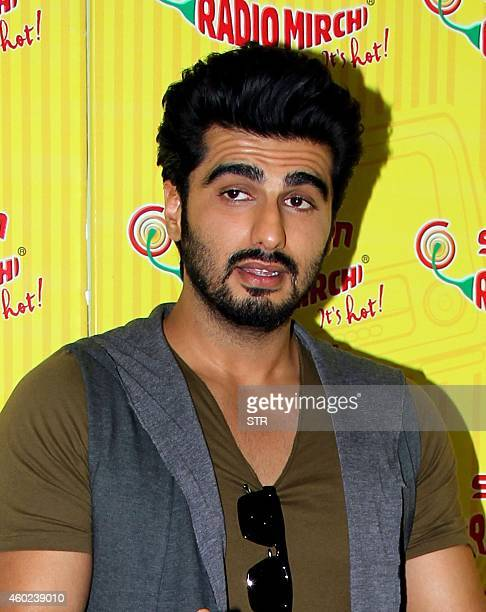 Indian Bollywood film actor Arjun Kapoor poses during the promotion of the Hindi film 'Tevar' at 983 FM studios in Mumbai on December 10 2014 AFP...