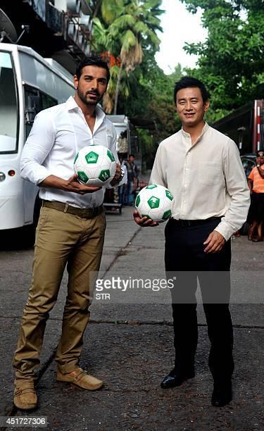 Indian Bollywood film actor John Abraham and Indian footballer Bhaichung Bhutia pose during the Indias Biggest Football Hangout using Google light...