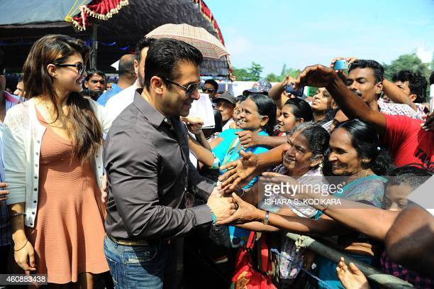 Indian Bollywood film actor Salman Khan and Sri Lankan Bollywood film actress Jacqueline Fernandez greet fans outside a free medical clinic organised...