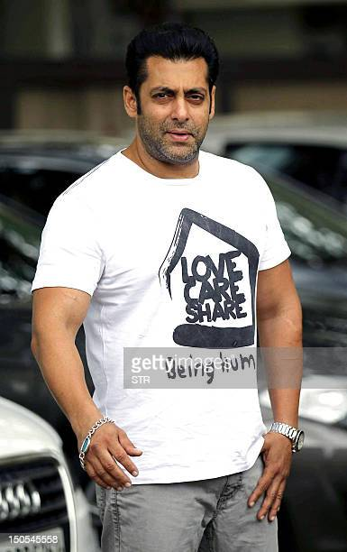 Indian Bollywood film actor Salman Khan greets wellwishers outside his residence during Eid alFitr in Mumbai on August 20 2012 AFP PHOTO