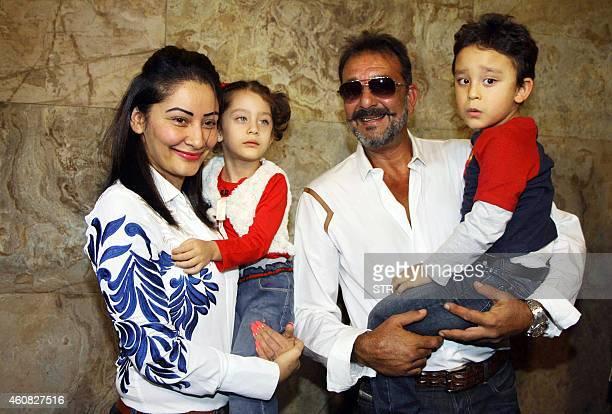 Indian Bollywood film actor Sanjay Dutt and his family attend the special screenig of Hindi film 'PK' in Mumbai on December 25 2014 AFP PHOTO