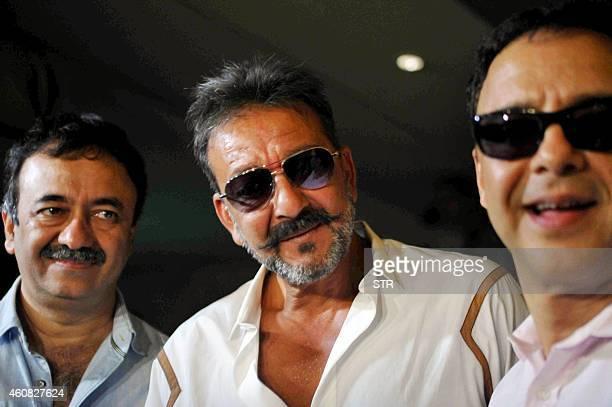 Indian Bollywood film actor Sanjay Dutt director Rajkumar Hirani and producer Vidu Vinod Chopr attend the special screening of Hindi film 'PK' in...