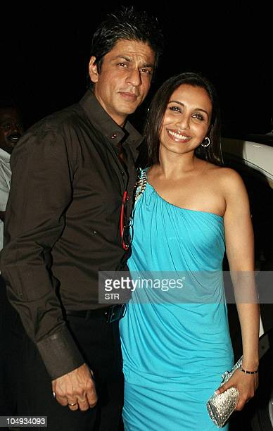 Indian Bollywood film actor Sharukh Khan poses with film actress Rani Mukharjee at the opening party of the HDIL Couture Week 2010 in Mumbai on...