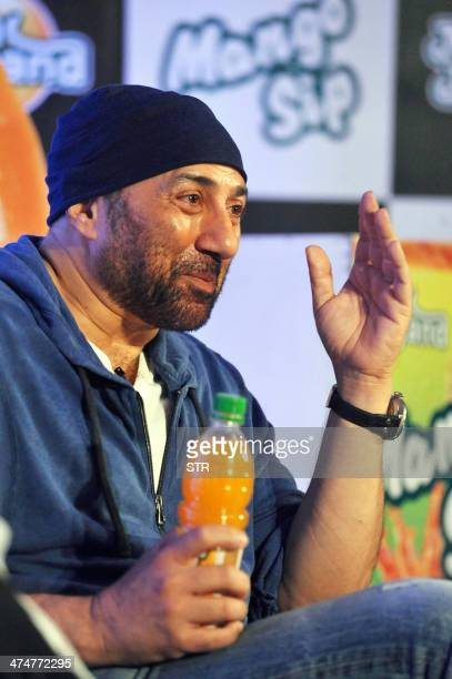 Indian Bollywood film actor Sunny Deol poses during a press conference to announce the new brand ambassador for Manapasand Fruit Juice in Mumbai on...