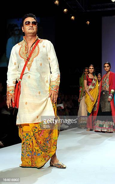 Indian Bollywood film actor Vinay Pathak showcases a creation by designer Agnimitra Paul during a fashion show on the fourth day of the Lakme Fashion...