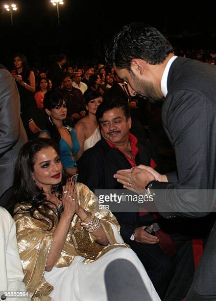 Indian Bollywood film actors Abhishek Bachchan and Shatrudhan Sinha with Rekha attend the Stardust Awards in Mumbai late on January 17 2010 AFP...