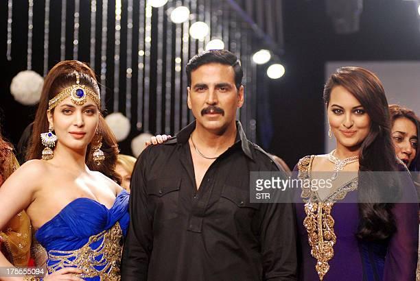 Indian Bollywood film actors Akshay Kumar and Sonakshi Sinha and Miss India Ankita Shorey walk the ramp for D'damas at the 4th edition of India...