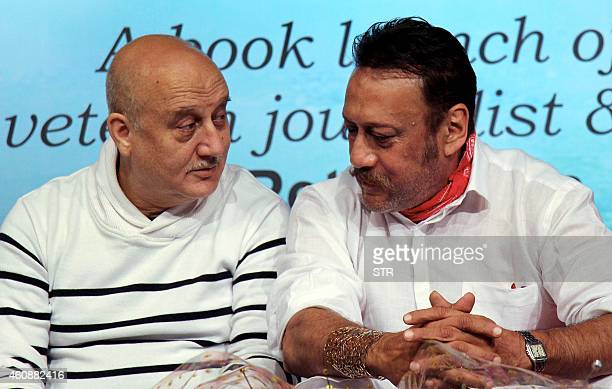 Indian Bollywood film actors Anupam Kher and Jackie Shroff interact during the book launch of 'Witnessing Wonders' by journalist Ali Peter John...