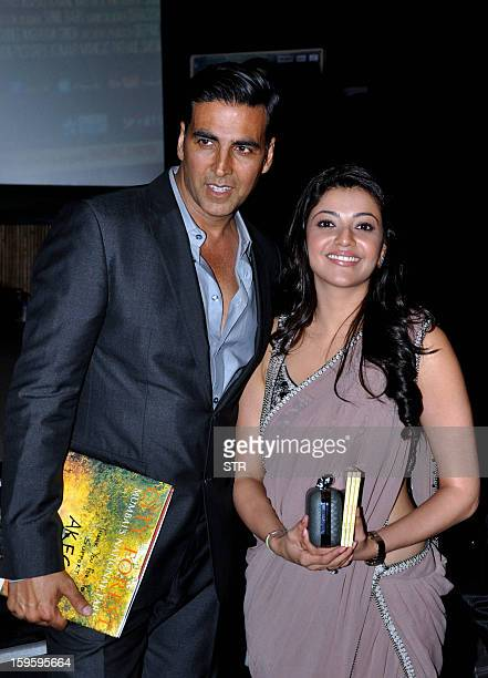 Indian Bollywood film actors Kajal Aggarwal and Akshay Kumar pose during the music launch of the upcoming film 'Special 26' directed by Neeraj Pandey...