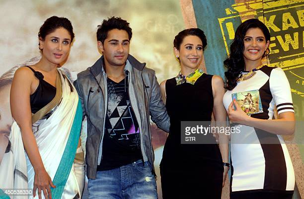 Indian Bollywood film actors Kareena and Karishma Kapoor with brother actor Armaan Jain and actress Deeksha Seth pose during the music launch of the...