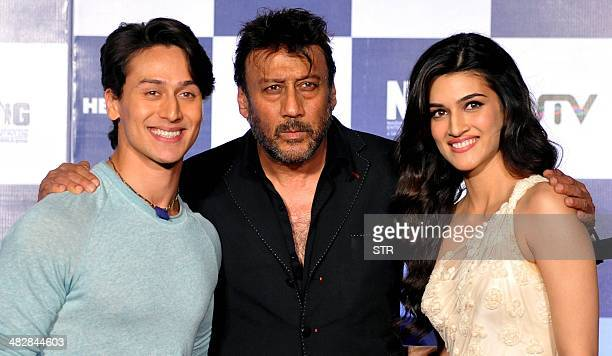 Indian Bollywood film actors Kriti Sanon Tiger Shroff and Jackie Schroff pose during the launch of the trailer of the upcoming Hindi film 'Heropanti'...