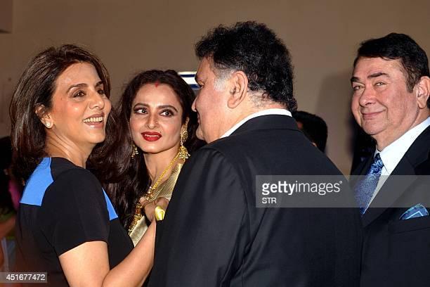 Indian Bollywood film actors Neetu Singh Rekha Rishi Kapoor and Randhir Kapoor attend the premier of Hindi film 'Lekar Hum Deewana Dil' in Mumbai on...