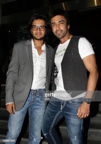 Indian Bollywood film actors Ritesh Deshmukh and Aashish Chaudhary attend the premiere of Indian Bollywood Hindi Film �Dabangg� in Mumbai on...