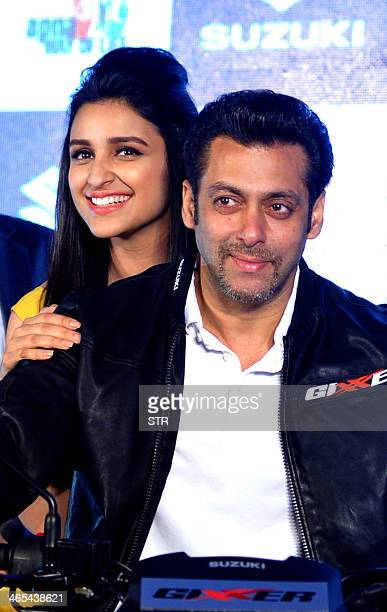 Indian Bollywood film actors Salman Khan and Parineeti Chopra pose during the launch of two new Suzuki wheelers 'Gixxer' and 'Lets' motorcycles in...