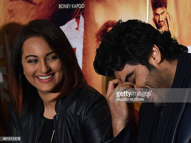 Indian Bollywood film actors Sonakshi Sinha and Arjun Kapoor react as they attend a promotional event for the upcoming Hindi film 'Tevar' in New...