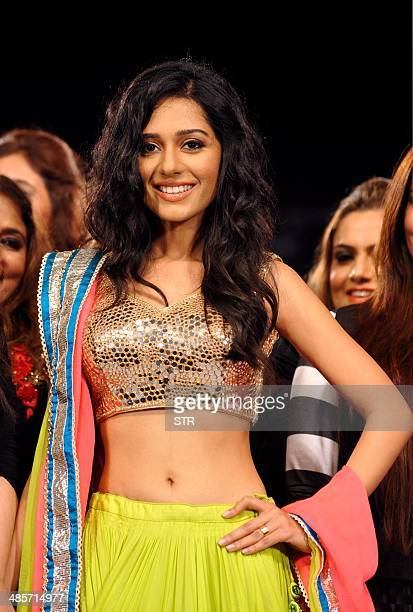 Indian Bollywood film actress Amrita Rao showcases a creation by designer Archana Kohhar during the fifth edition of the Smile Foundation charity...