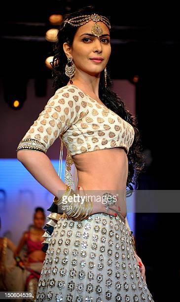 Indian Bollywood film actress Ankita Shorey showcases jewellery designer Gitanjali Jewels creations as she walks the ramp during the fourth day of...