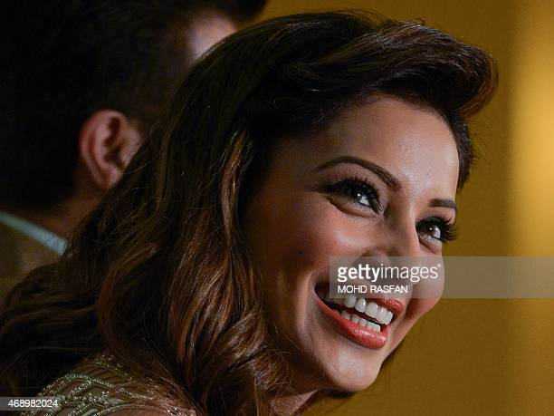 Indian Bollywood film actress Bipasha Basu smiles as she speaks during a press briefing for the 16th International Indian Film Awards at a hotel in...