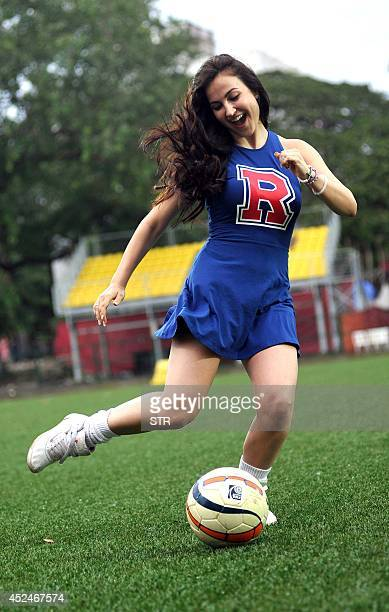 Indian Bollywood film actress Elli Avram plays during a charity football match organized by Ira Khan daughter of film actor Aamir Khan in Mumbai on...