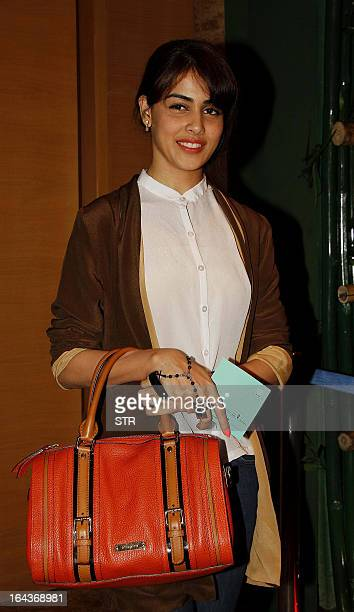 Indian Bollywood film actress Genelia D'Souza attends the second day of the Lakme Fashion Week Summer/Resort 2013 in Mumbai on March 23 2013 AFP PHOTO