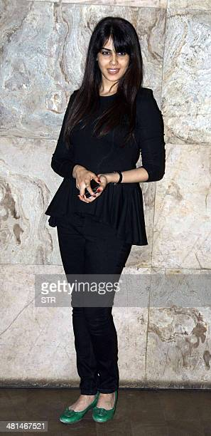 Indian Bollywood film actress Genelia D'Souza poses at the showing of the Marathi film Yellow directed by Mahesh Limaye and produced by Uttung...