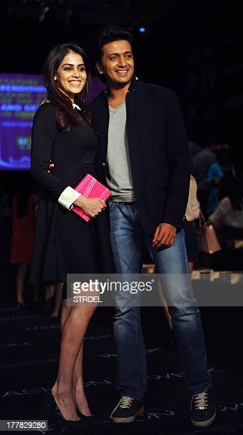 Indian Bollywood film actress Genelia DSouza poses with actor Riteish Deshmukh as they attend the Lakme Fashion Week Winter/Festival 2013 in Mumbai...