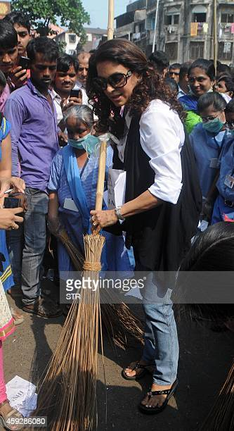 Indian Bollywood film actress Juhi Chawla participates during a Swachh Bharat Abhiyann with mentally disabled children from the Munshi Yojana...