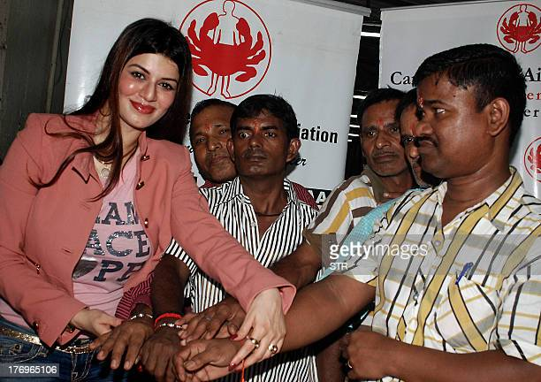 Indian Bollywood film actress Kainaat Arora poses with cancer patients during celebration of the Hindu festival of Brothersister relationship 'Raksha...