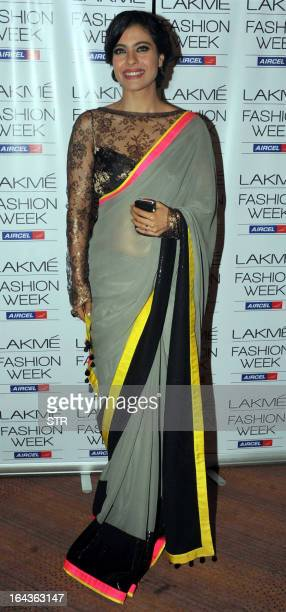 Indian Bollywood film actress Kajol Devgan poses in a creation by designer Manish Malhotra on the first day of the Lakme Fashion Week Summer/Resort...