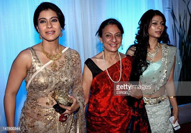 Indian Bollywood film actress Kajol her mother Tanuja Mukherjee and sister Tanisha pose during the wedding reception of film actress Esha Deol and...