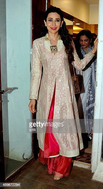 Indian Bollywood film actress Karishma Kapoor poses during the Notandas Jewellers' launch of Meenakari Jewellery designed by Sunita Shekhawat in...