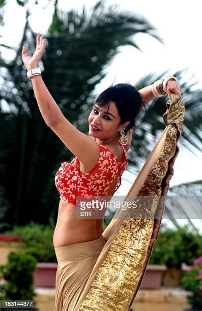 Indian Bollywood film actress Kavitta Verma poses during the photo shoot for 'Dandiya Raas' traditional folk dance performed in Hindu Goddess Durga's...