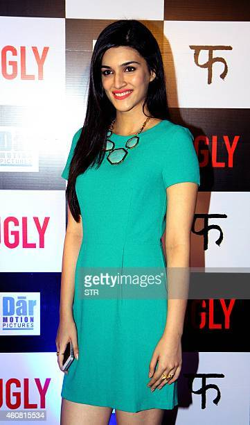 Indian Bollywood film actress Kriti Sanon poses at the premier of Hindi Film 'Ugly' written and directed by Anurag Kashyap in Mumbai on December 23...