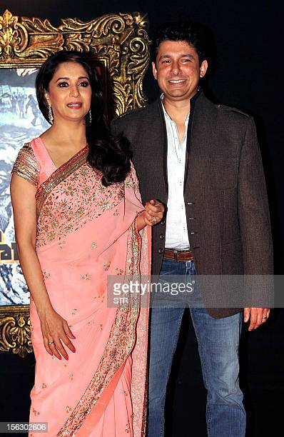 Indian Bollywood film actress Madhuri Dixit and her husband Shriram Nene pose on the red carpet at the premiere of the Hindi film 'Jab Tak Hai Jaan'...