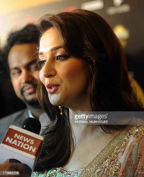 Indian Bollywood film actress Madhuri Dixit Nene speaks to the media as she arrives to attend the 14th International Indian Film Academy Rocks event...