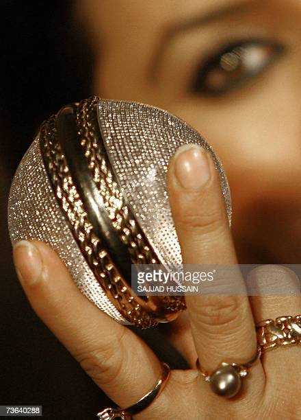 Indian Bollywood film actress Mahima Choudhary displays one of two diamond studded cricket balls at a function in Mumbai 20 March 2007 The balls...