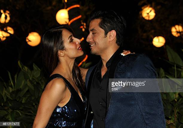 Indian Bollywood film actress Malaika Arora Khan and Pakistani actorsinger Ali Zafar attend the 50th birthday party of Bollywood film director...
