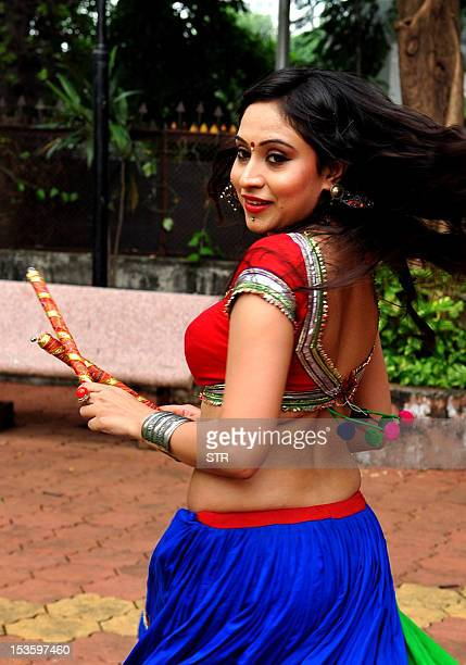 Indian Bollywood film actress model and singer Priya Patel poses during the performance of the Garba and Dandiya at the celebrations of the Navratri...