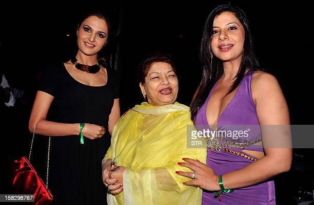 Indian Bollywood film actress Monika Bedi and dance choreographer Saroj Khan with Indian Bollywood dancer and actress Sambhavna Seth celebrate her...